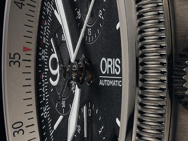 Montre Oris Big Crown X1 Calculator, détails du cadran et de la lunette tournante avec règle à calcul circulaire.